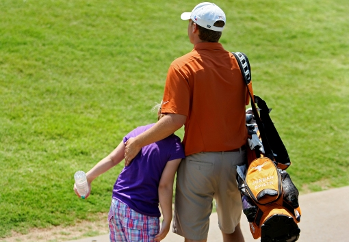 Norman, Oklahoma--05/19/12--Jordan Spieth of Texas gets a hug from his sister, Ellie, 10 after the final round of the Southwest Regional Championship at Jimmie Austin Golf Club in Norman, Oklahoma.--(Photo by Tracy Wilcox/GOLFWEEK)